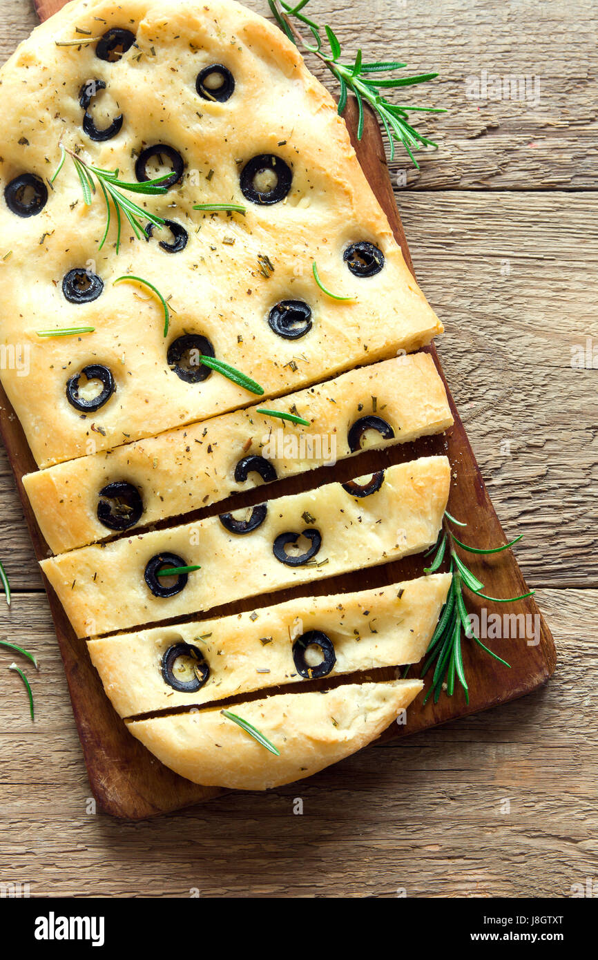 Traditional Italian Focaccia with black olives and rosemary - homemade flat bread focaccia - Stock Image