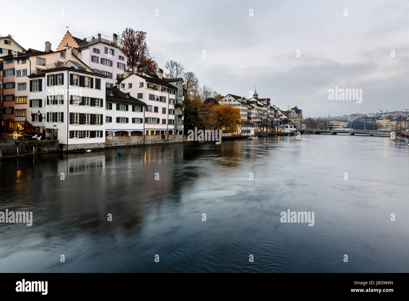 Zurich Skyline and the River Limmat in the Evening, Switzerland - Stock Image
