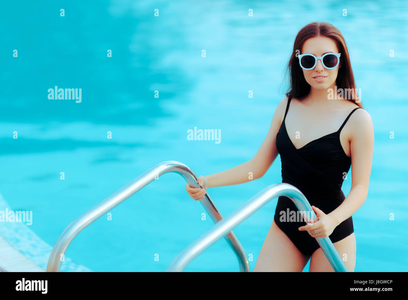 f273974af5 Summer Girl with Fashion Sunglasses and Black Swimsuit by the Pool - Stock  Image