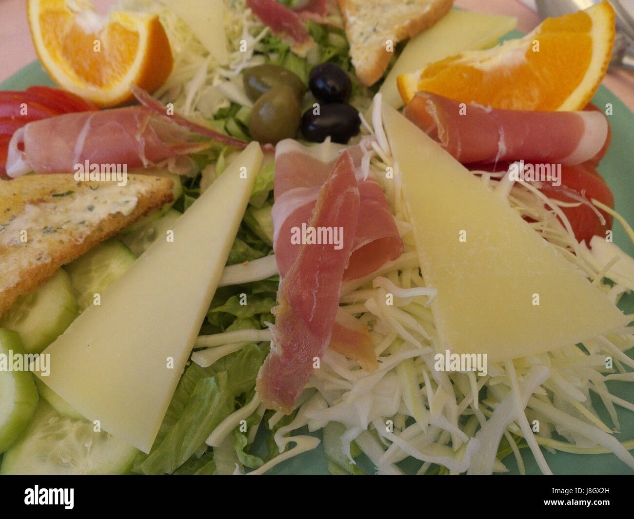 A culinary cheese and meats platter for lunch Stock Photo