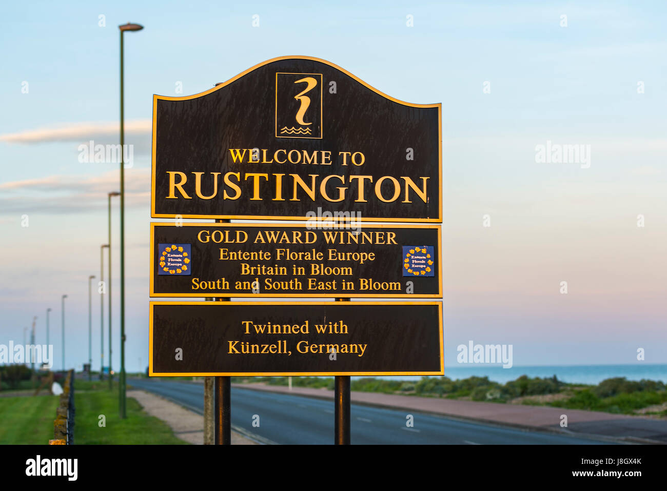 Welcome to Rustington sign on the seafront road in Rustington, West Sussex, England, UK. - Stock Image