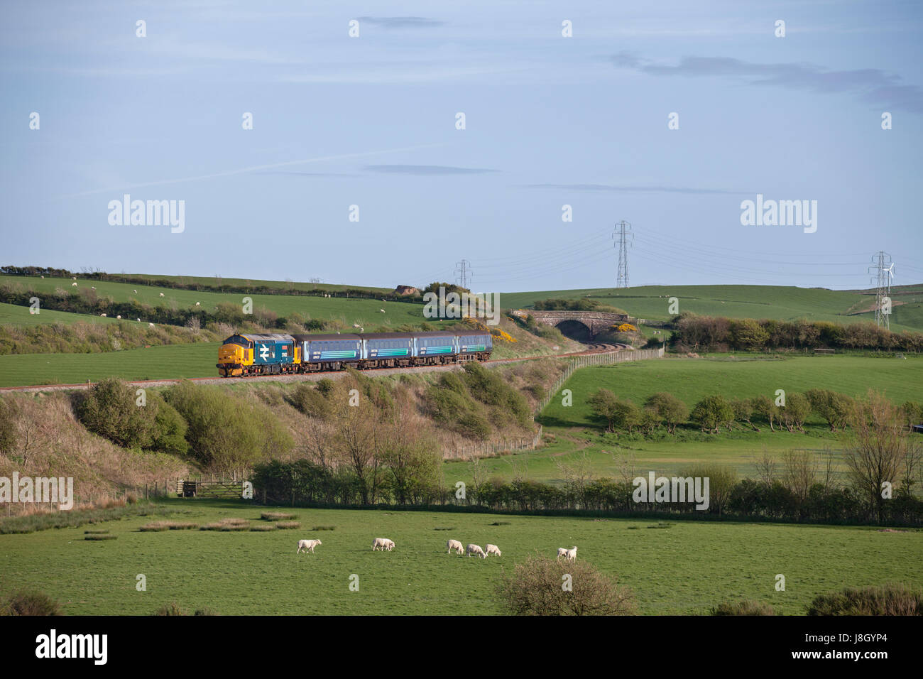 22/04/2017 Annaside (south of Bootle) Direct rail Servicex Class 37 locomotive hauling Northern Rail Barrow In Furness - Stock Image