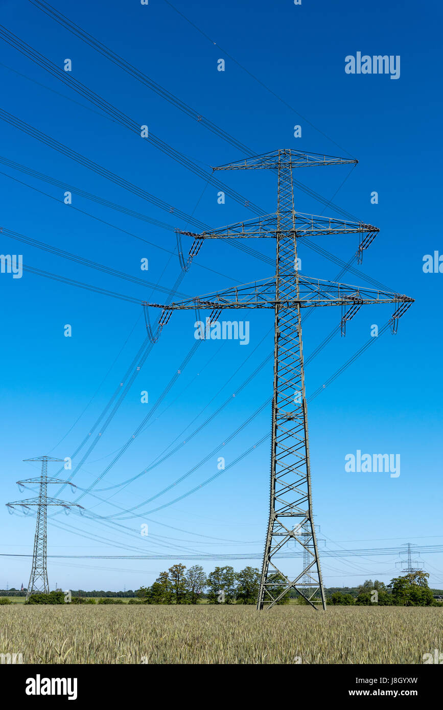 Electrical power lines seen in rural Germany - Stock Image