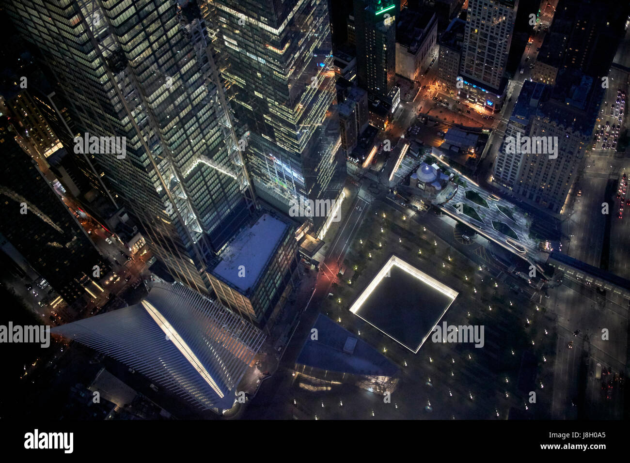 aerial night view of the national september 11 memorial museum and oculus transport hub New York City USA - Stock Image