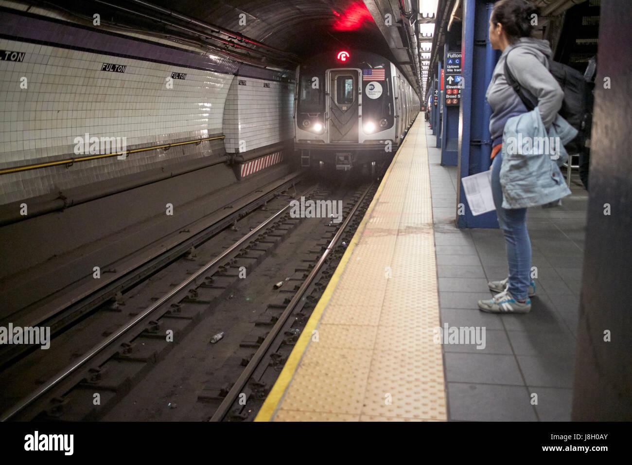 New York City subway train approaching platform fulton station manhattan USA - Stock Image
