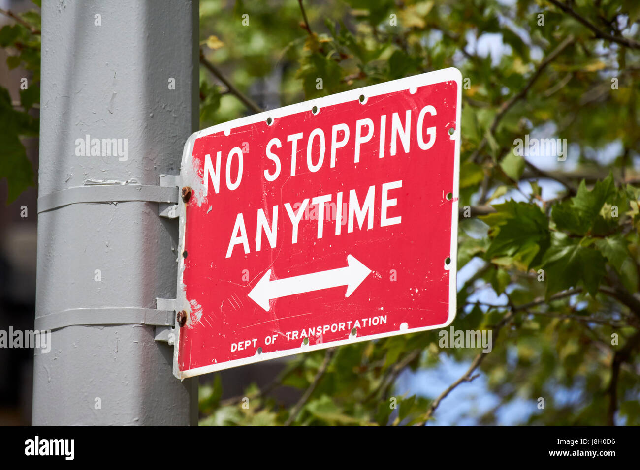 no stopping anytime New York City street signs USA - Stock Image