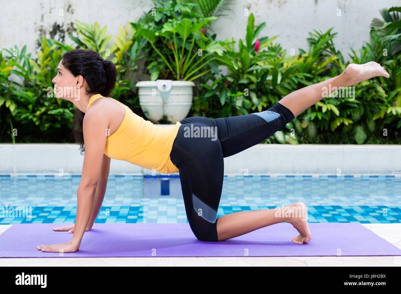 Young woman exercising for lower body workout - Stock Image