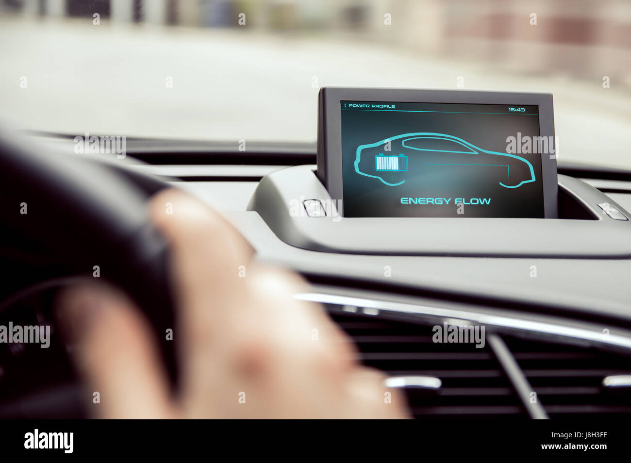 Electronic car display with information about energy flow - Stock Image