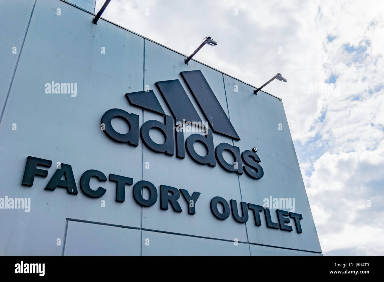 Copenhagen, July 7, 2016, Adidas Factory outlet. Logo aganist the ...