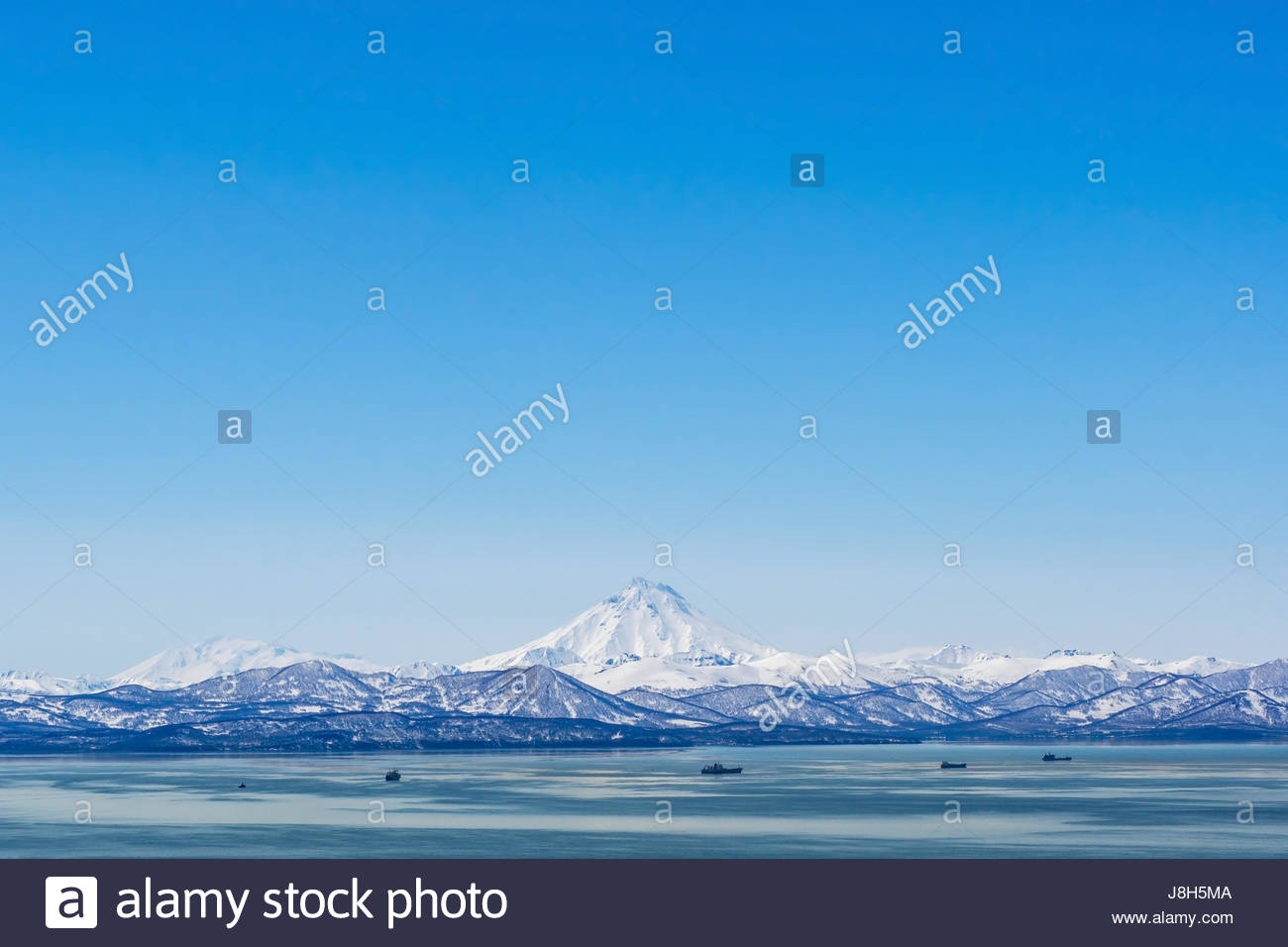 Stratovolcano Vilyuchinsky above Avacha bay Kamchatka Russia - Stock Image