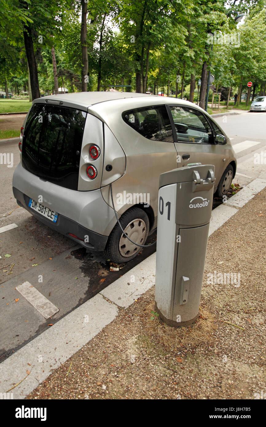 autolib, electric car charging on a Paris street. Rental car service. Paris street. - Stock Image
