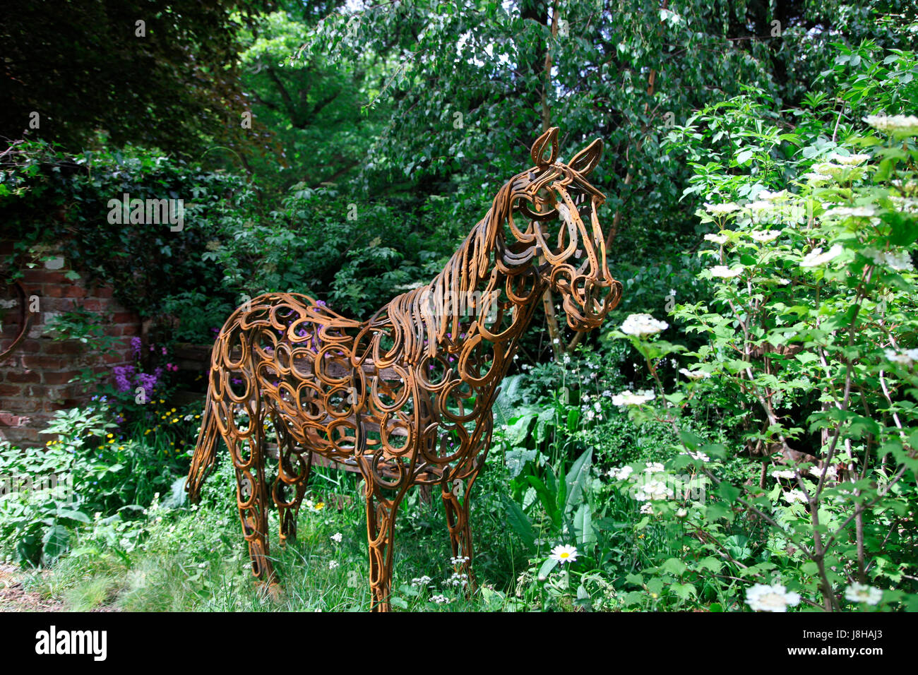 Horse constructed from horseshoes in the World Horse Welfare Garden, an Artisan Garden at RHS Chelsea Flower Show - Stock Image