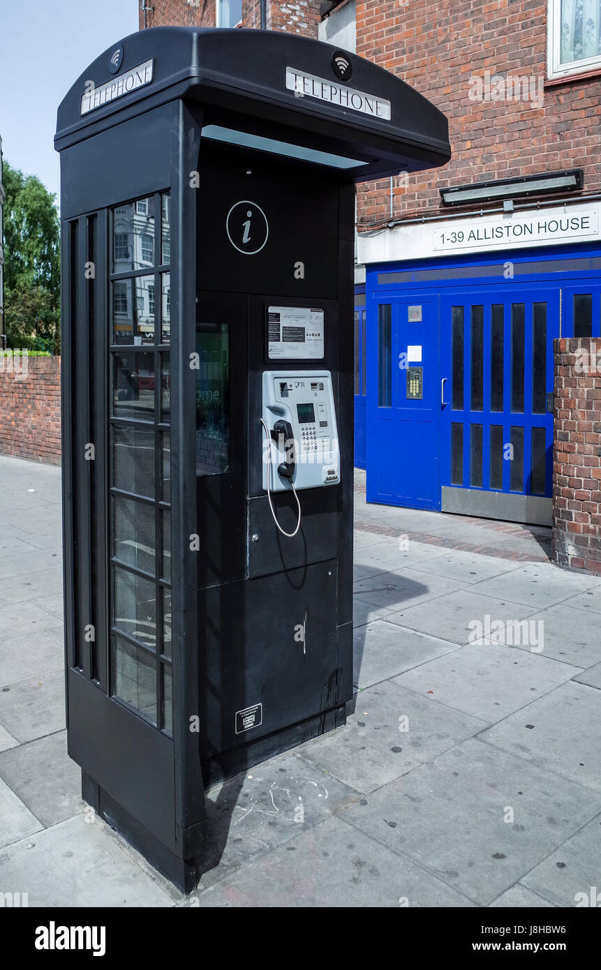A New World Telecom Phone box, with a stylistic reference to the traditional British Phone Box, in East London - Stock Image