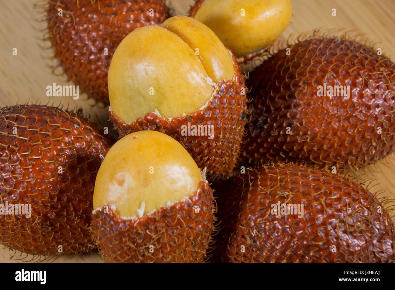 Close up of salak fruit ( Salacca zalacca) on wood background - Stock Image