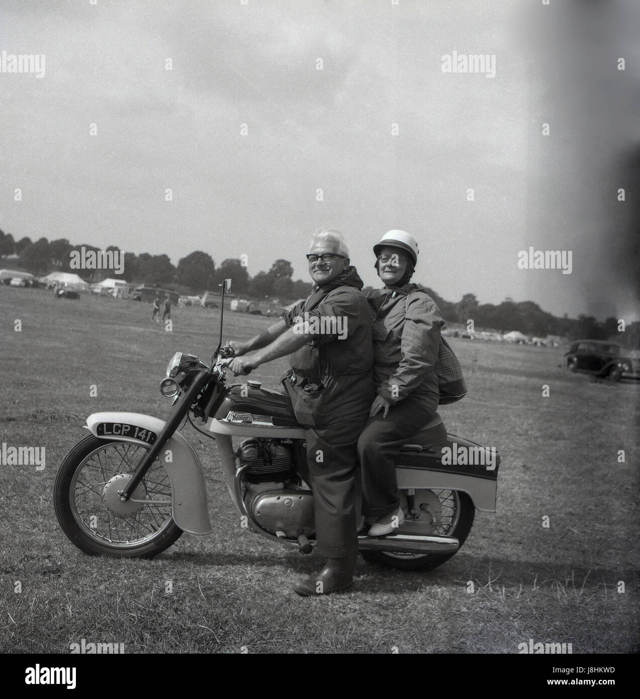 England, 1959, historical, happy elderly couple on their British made Norton motocycle. - Stock Image