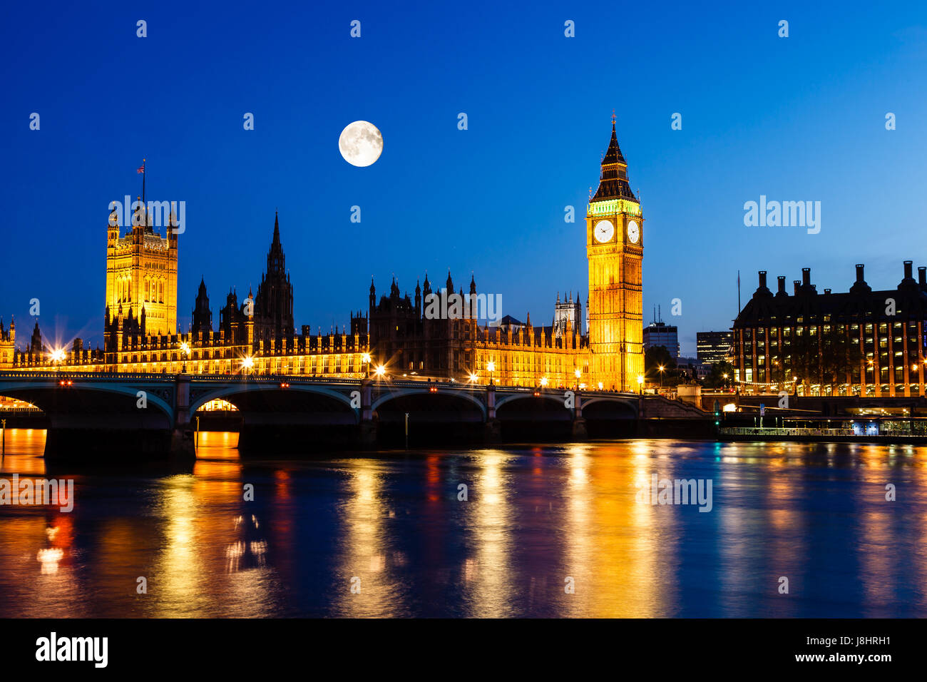 Full Moon above Big Ben and House of Parliament, London, United Kingdom - Stock Image