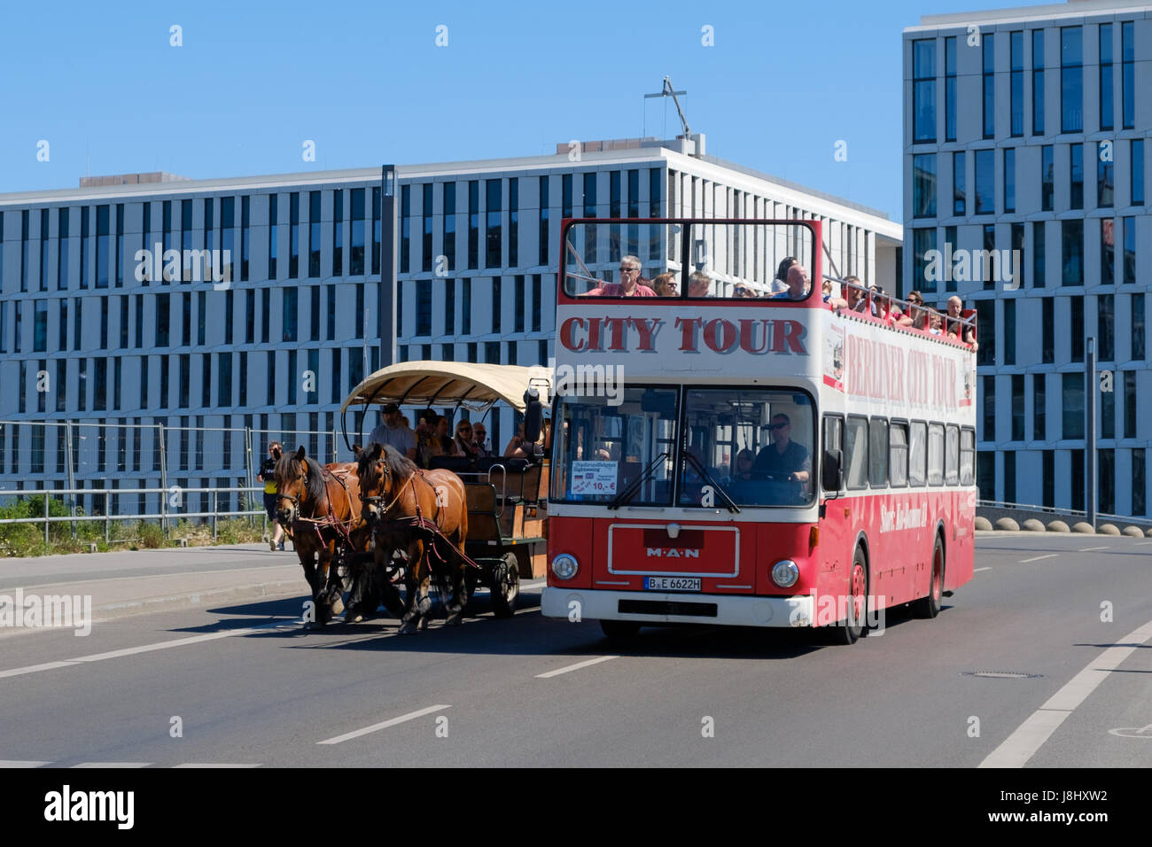 Berlin, Germany - may 27, 2017: A doubledecker sightseeing busand a horse carriage  doing a sightseeing busin Berlin - Stock Image