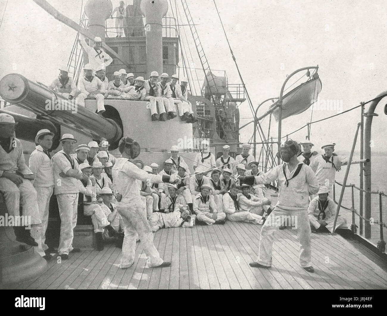Watching a fencing bout aboard an American warship, circa 1915 - Stock Image