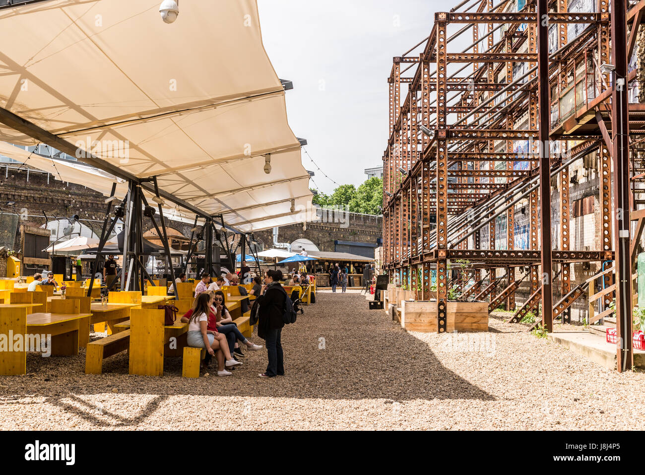 Mercato Metropolitano, a disused paper factory, in Elephant and Castle, is now a market space and lifestyle hub - Stock Image