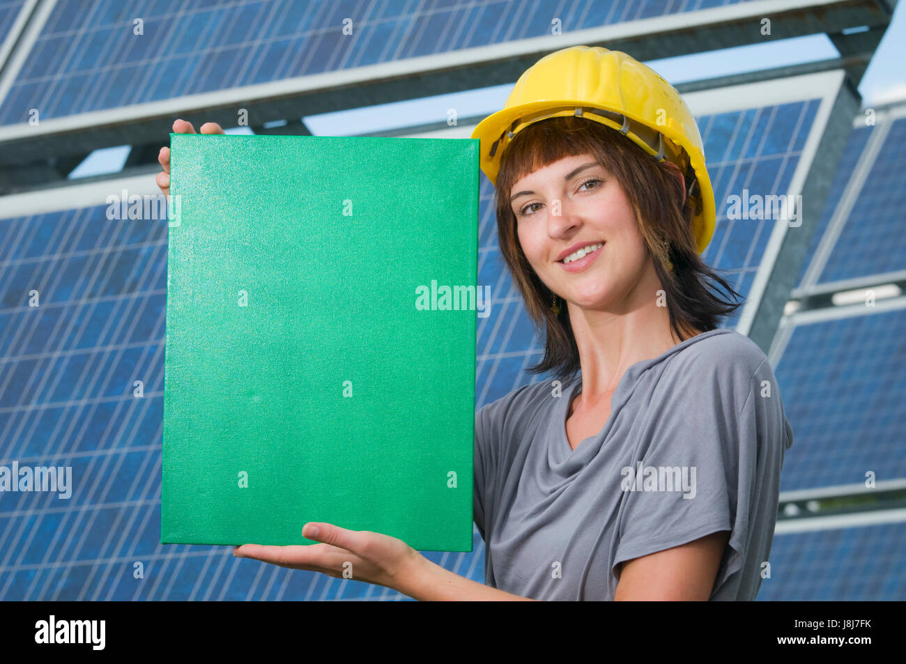 greencard in the hands of young lady - Stock Image