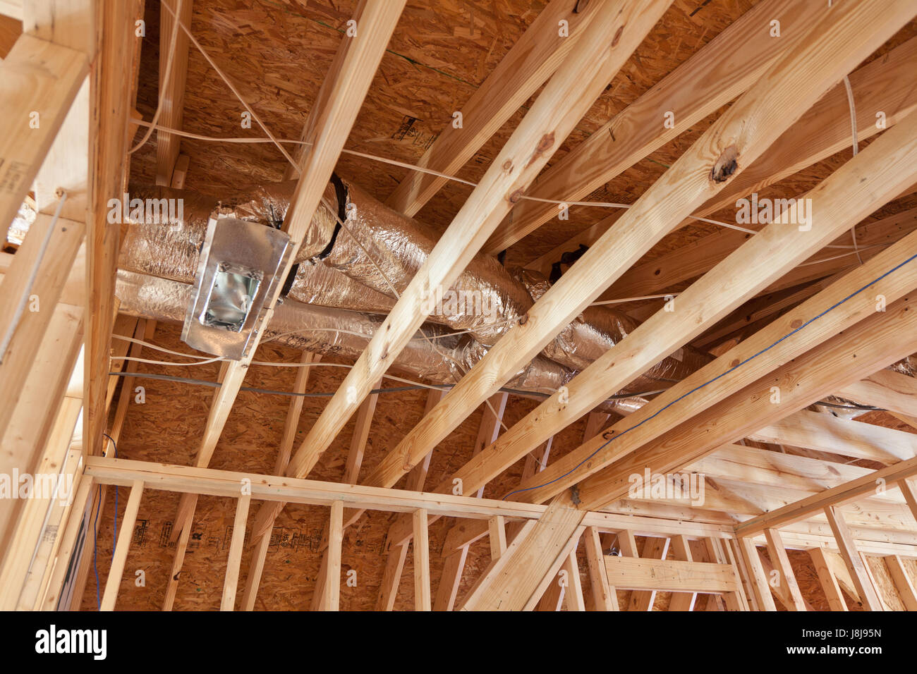New home construction with duct work in attic space - Stock Image
