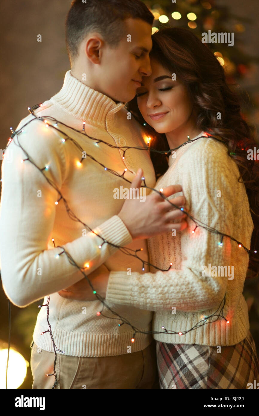 Young Lovely Romantic Couple Wrapped In Garland Caucasian Man And