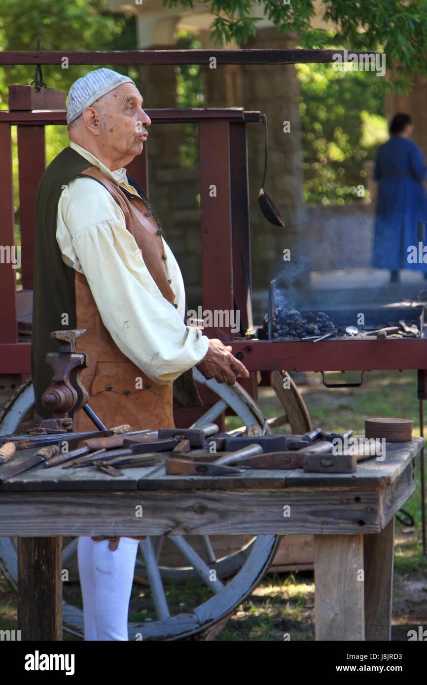 Man in blacksmith costume for memorial day reenactment of us civil war - Stock Image