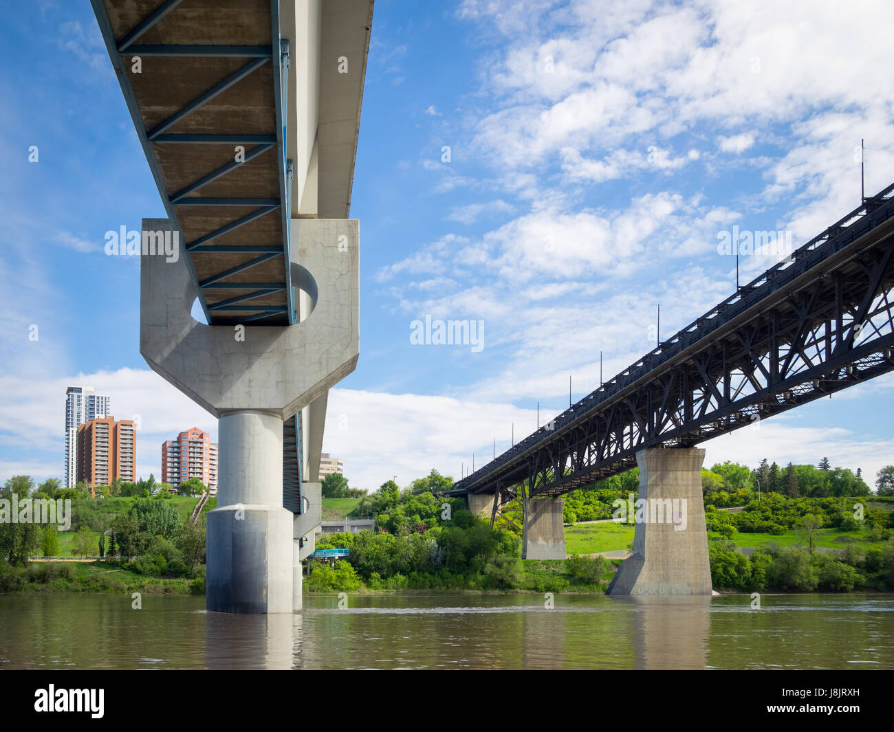 The Dudley B. Menzies Bridge (left) and High Level Bridge in Edmonton, Alberta, Canada, as seen from a boat on the - Stock Image