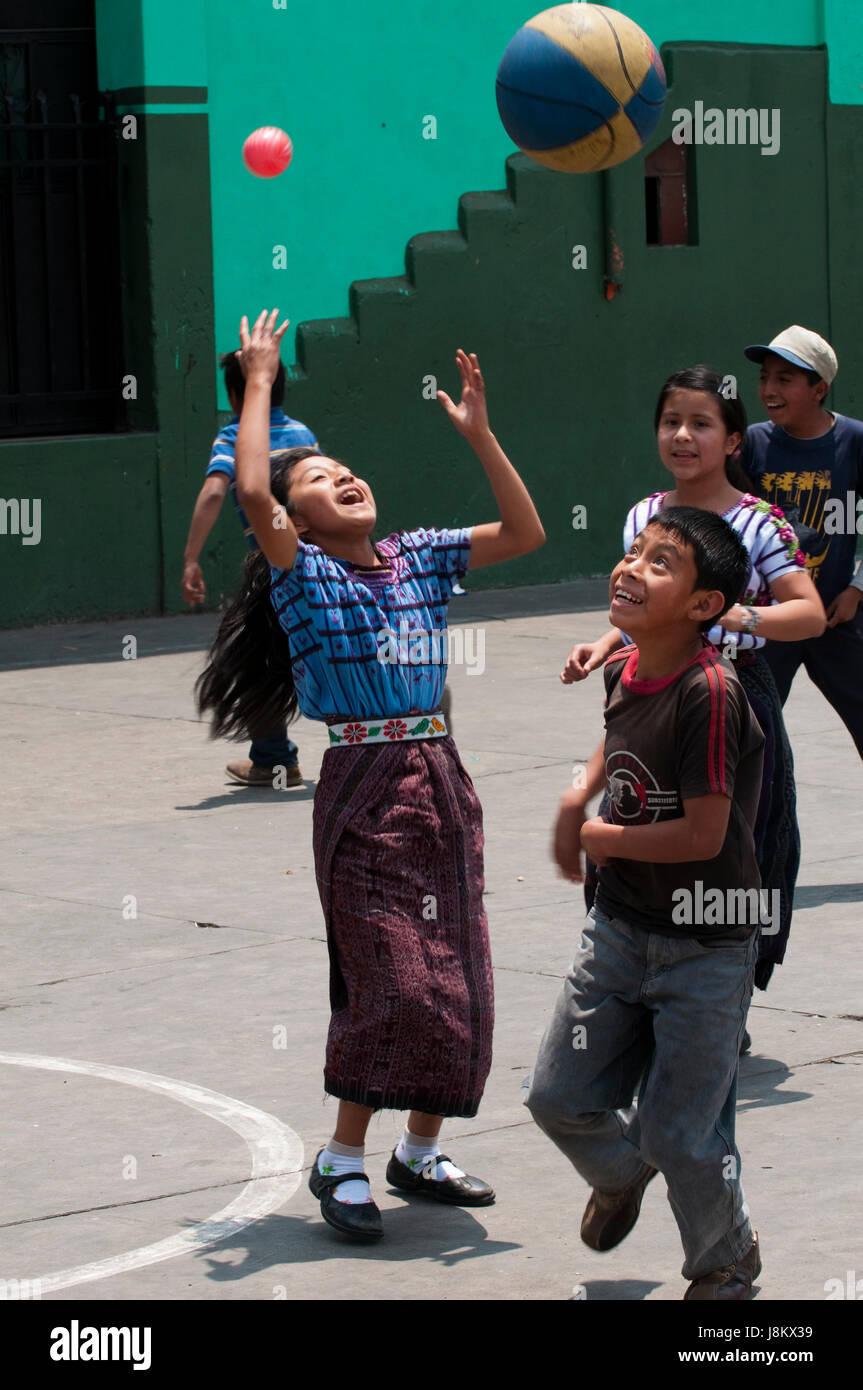 Girl playing basketball, Santiago Atitlan, Lake Atitlan, Guatemala. Stock Photo