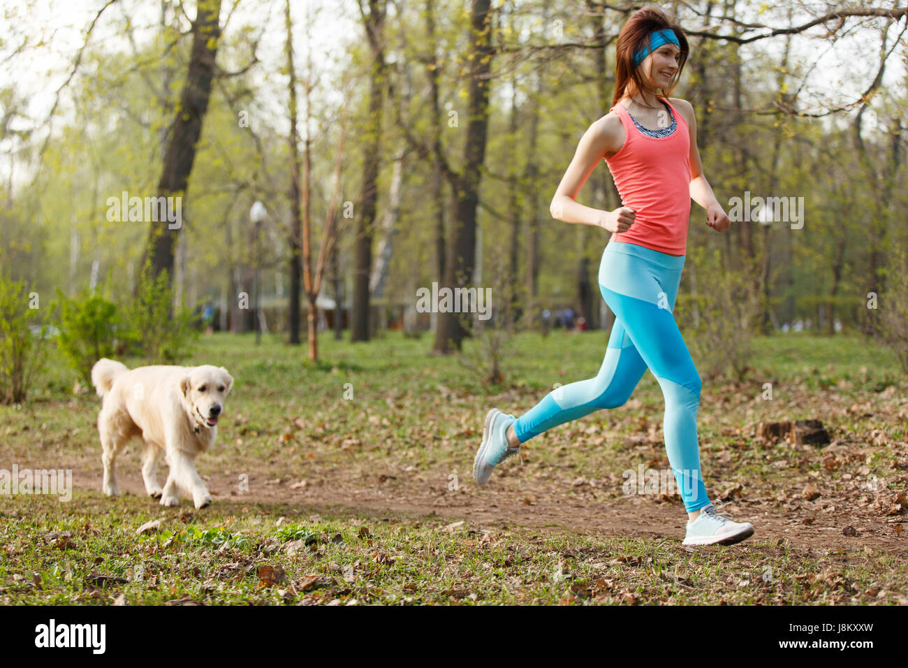 Woman with labrador in park - Stock Image