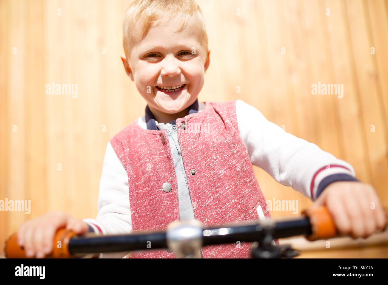 Photo of boy with bicycle - Stock Image