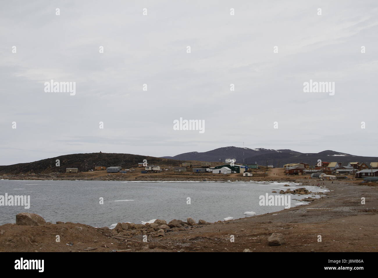 Overcast day in the Inuit community of Qikiqtarjuaq, Nunavut in the high Canadian arctic located on Broughton Island, - Stock Image