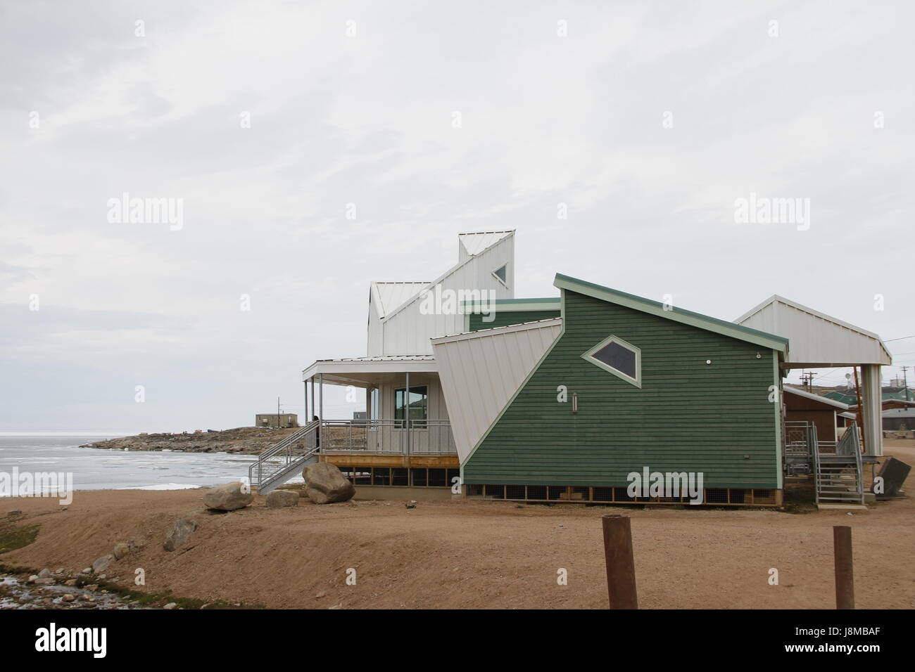 Parks Canada building in the community of Qikiqtarjuaq, Nunavut in the high Canadian arctic located on Broughton - Stock Image