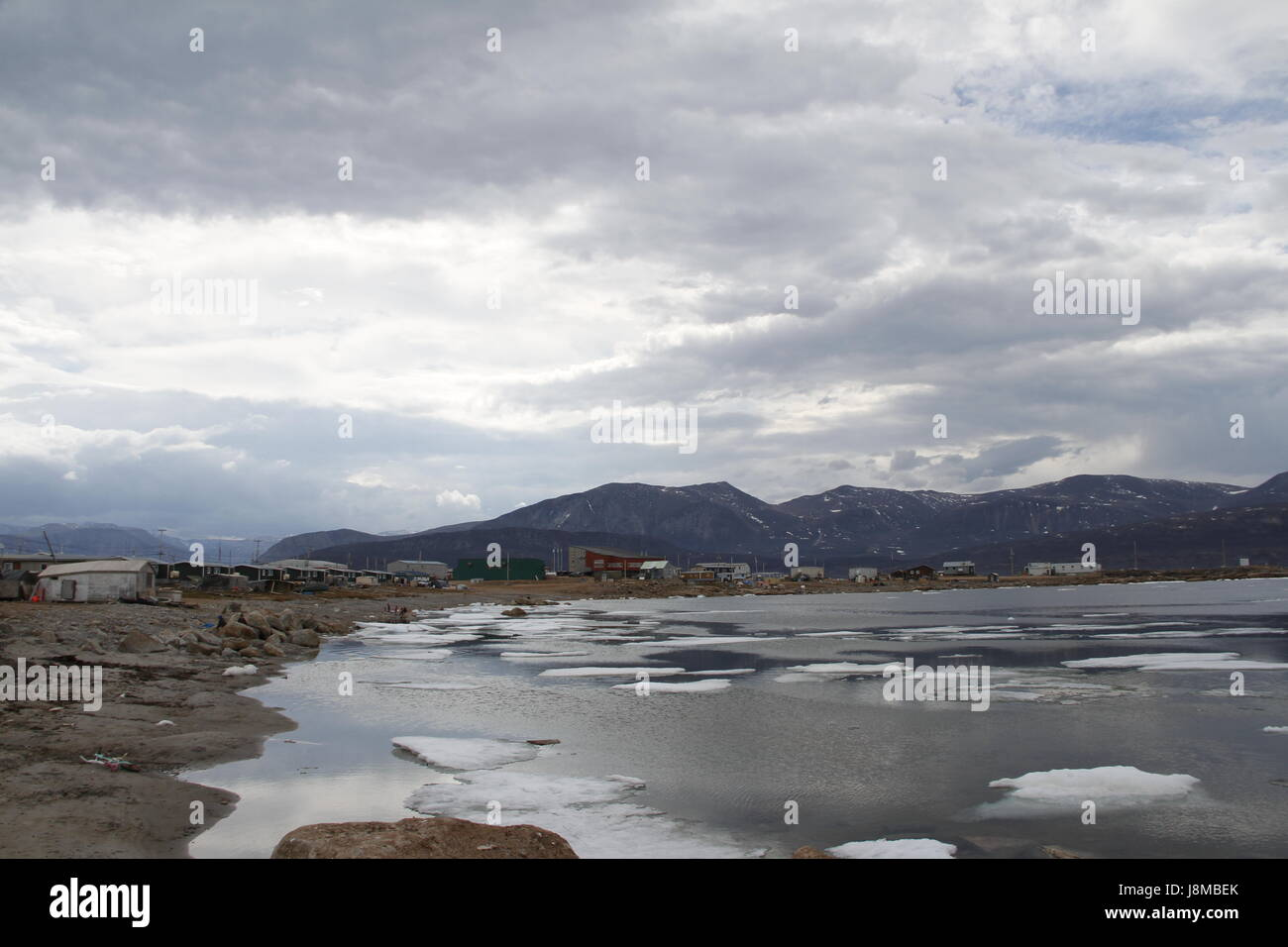 Overcast day in the community of Qikiqtarjuaq, Nunavut in the high Canadian arctic located on Broughton Island, - Stock Image
