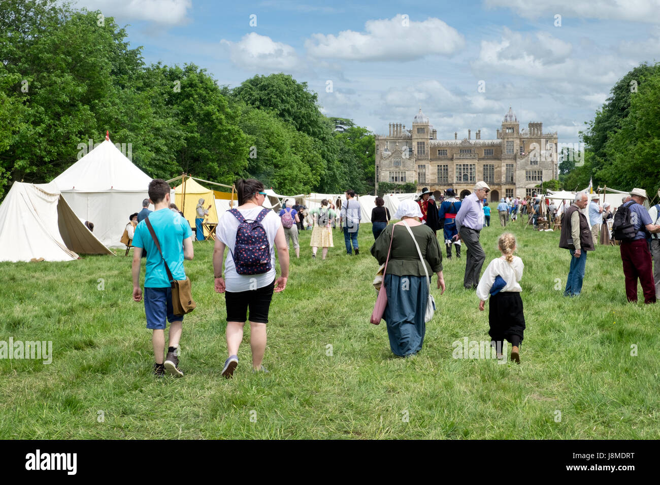 Visitors at a 17th century re-enactment event staged by the Sealed Knot at Charlton Park near Malmesbury, Wiltshire,UK. - Stock Image