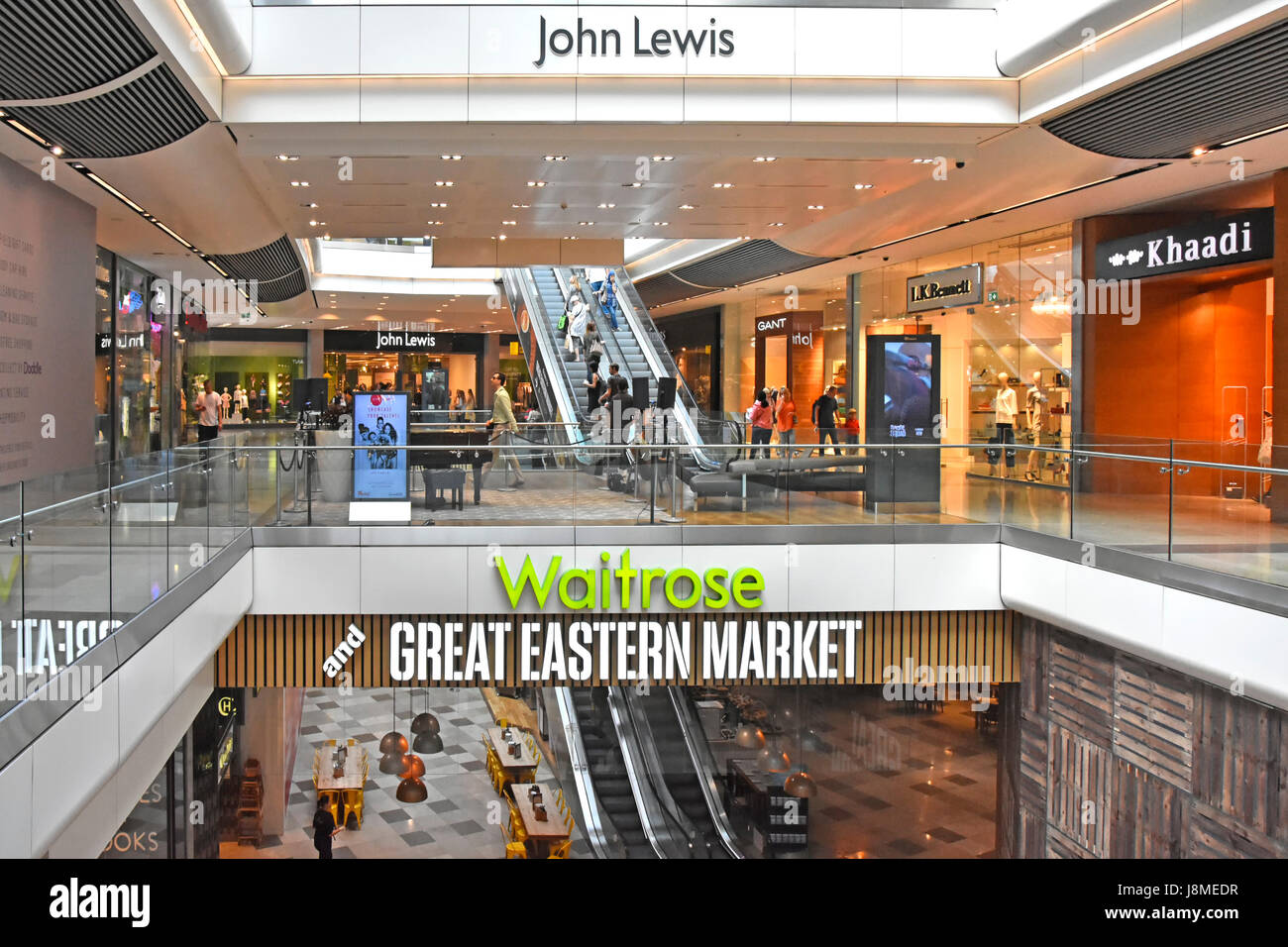 77288d299d Interior Westfield shopping centre Stratford City London UK mall with sign  for Waitrose supermarket & also Great Eastern Market & John Lewis sign