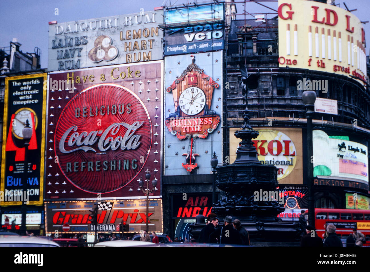 Vintage image of Piccadilly Circus in London taken in April 1967 showing various billboards of the time - Stock Image