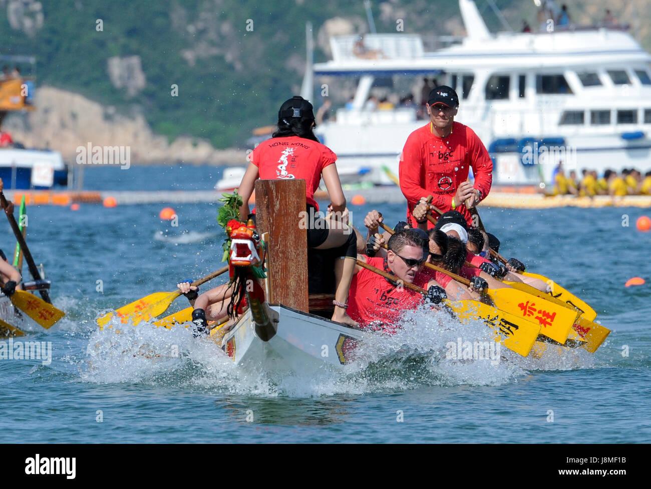 Team Stormies.Annual International Dragon Boat races at Stanley Beach, Hong Kong Island, Hong Kong. - Stock Image