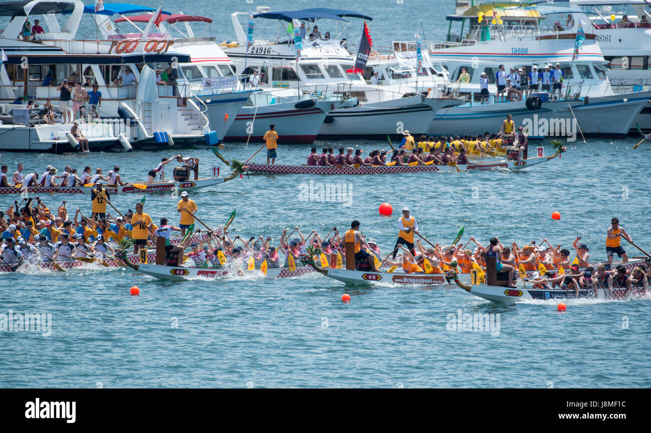 Spectator boats line up by the race start line.Annual International Dragon Boat races at Stanley Beach, Hong Kong - Stock Image