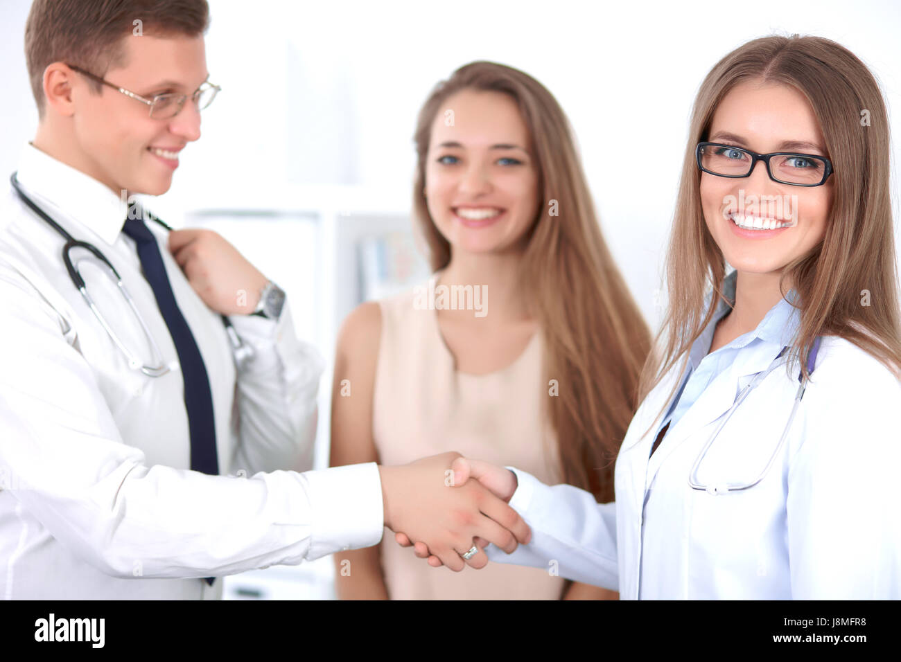 Two doctors and a patient