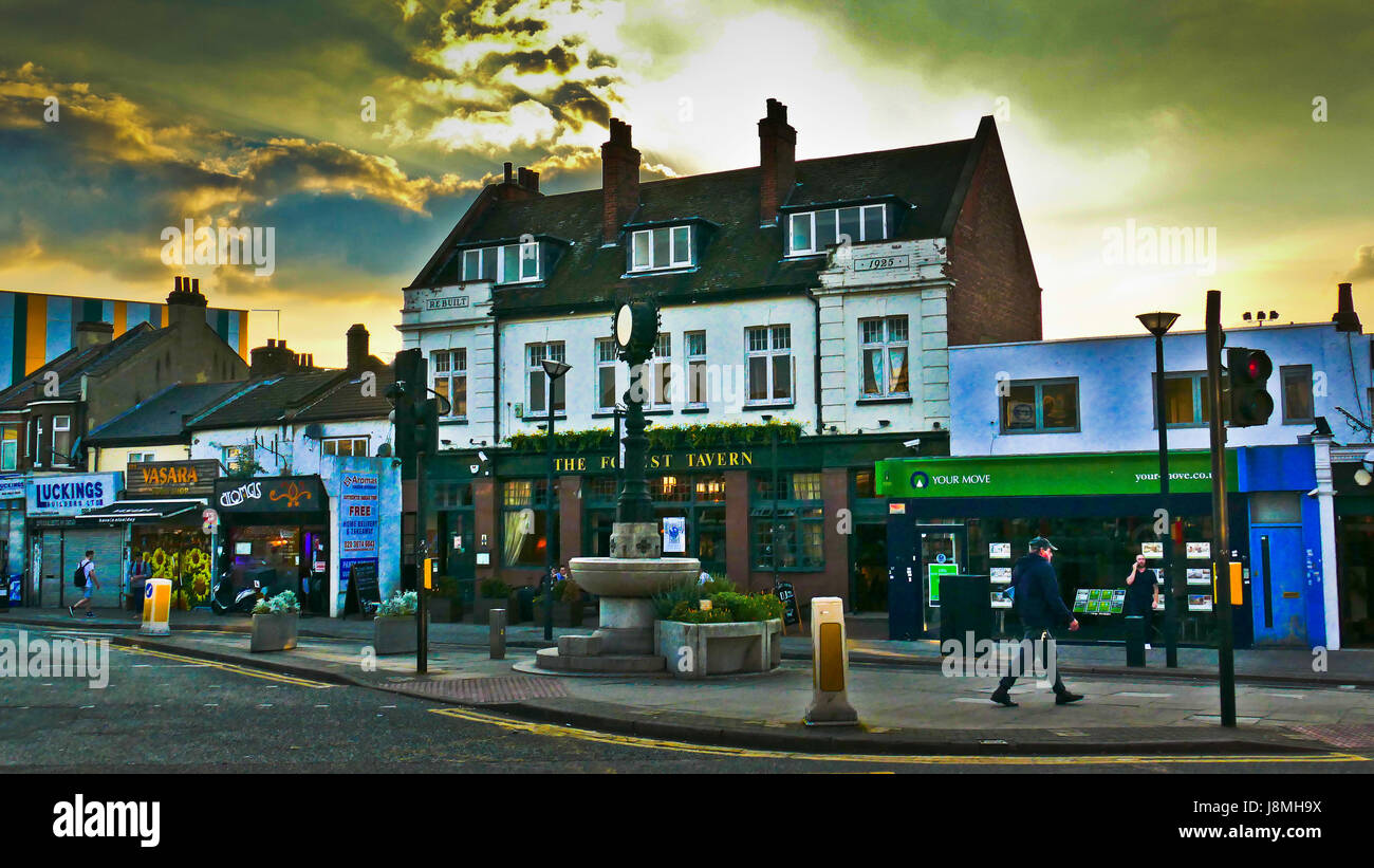 Parade of shops and the Forest Tavern pub at the junction of Woodgrange `Road and Forest Lane, Forest Gate. - Stock Image