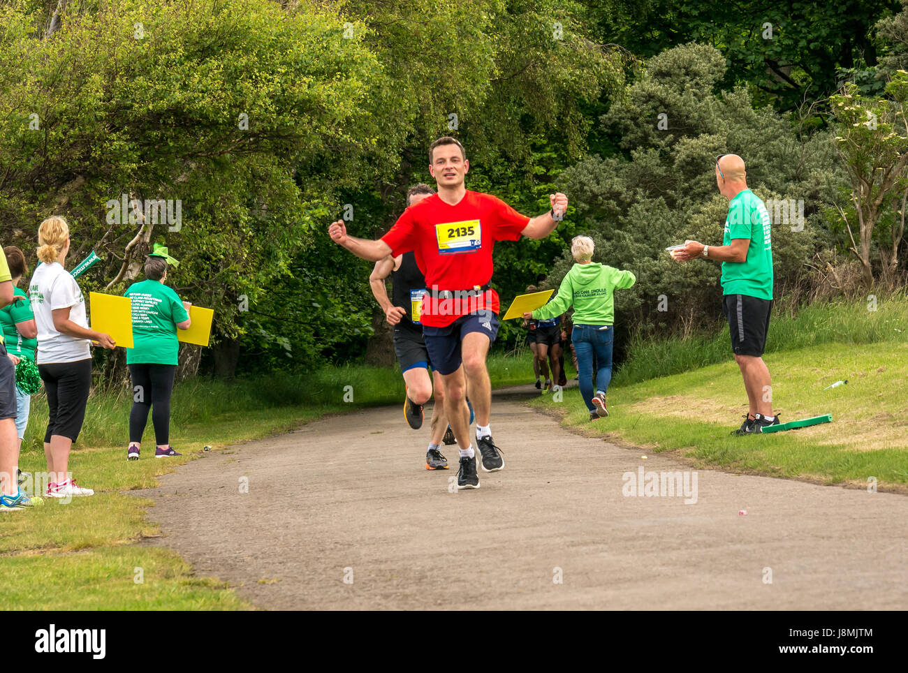 Runners in the Edinburgh Marathon Festival 2017 in Gosford Estate, East Lothian, Scotland, UK at Mile 18, with Male - Stock Image