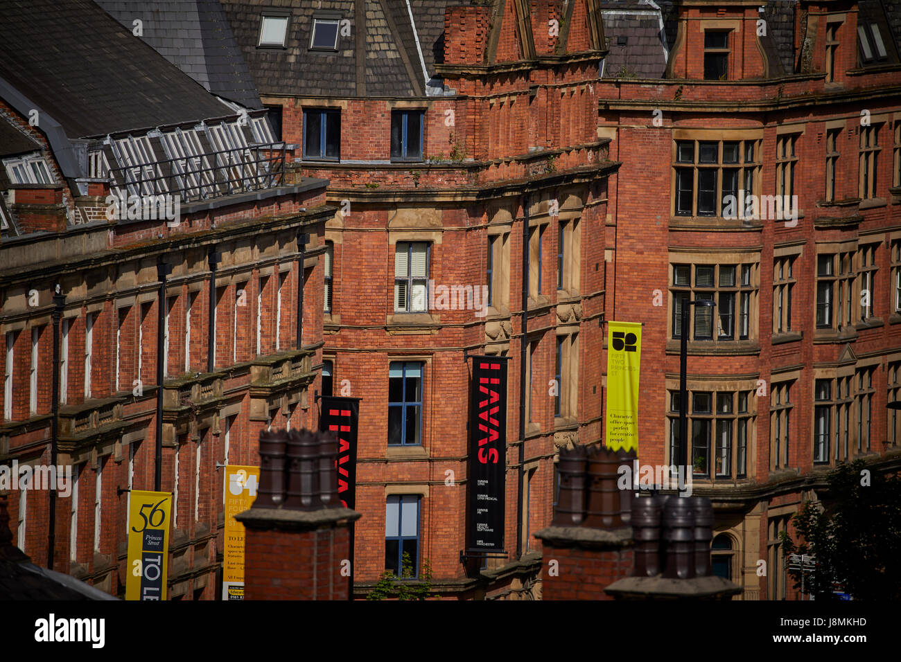 Traditional brick built offices on Princess Street  Manchester city centre UK - Stock Image