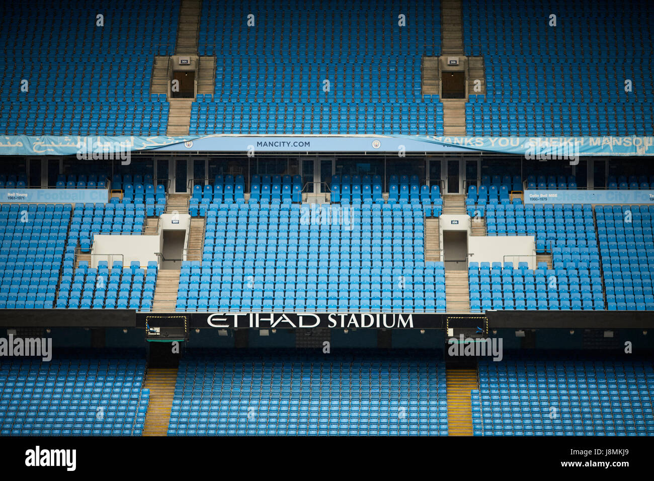 Manchester City Etihad Stadium posh seats with round logo. - Stock Image