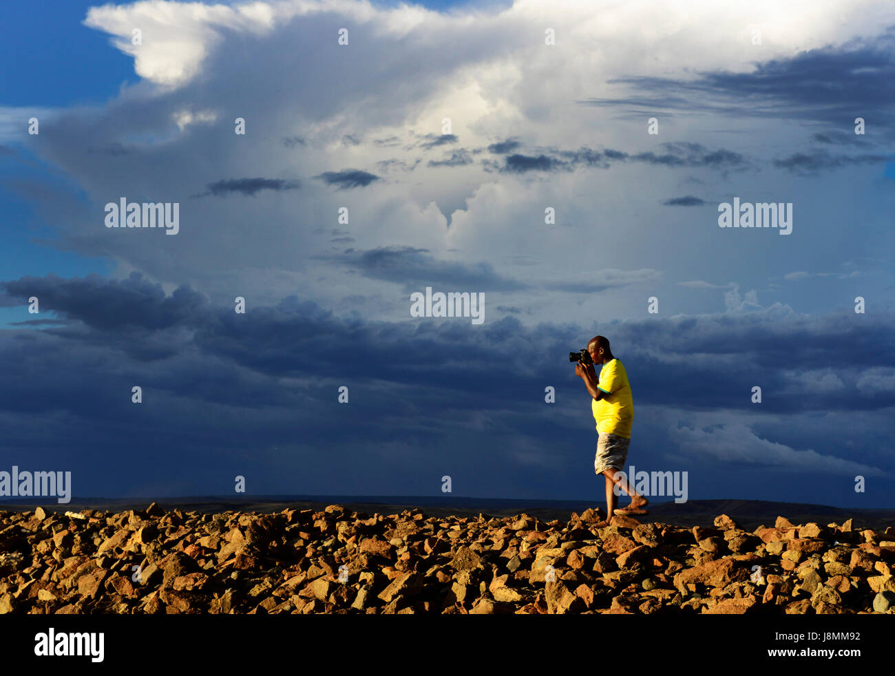 A photographer in action by Lake Turkana in Kenya. - Stock Image