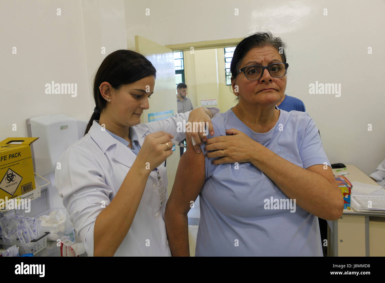 Annual vaccination campaign against influenza in a public health office at Sao Paulo city. This year with three - Stock Image