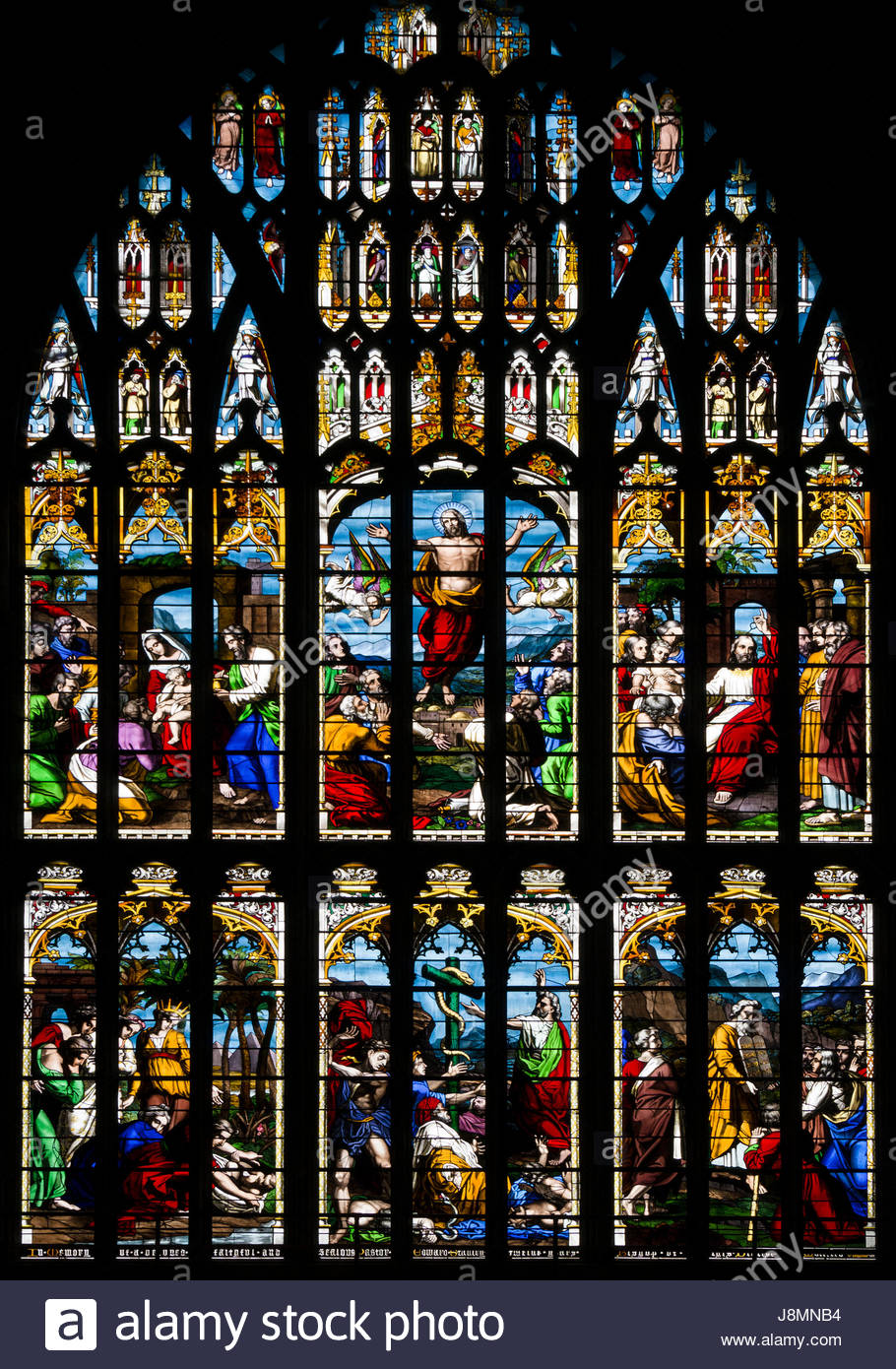 Stained Glass Windows And Gothic Arch Tracery Of The West Window Norwich Cathedral England UK