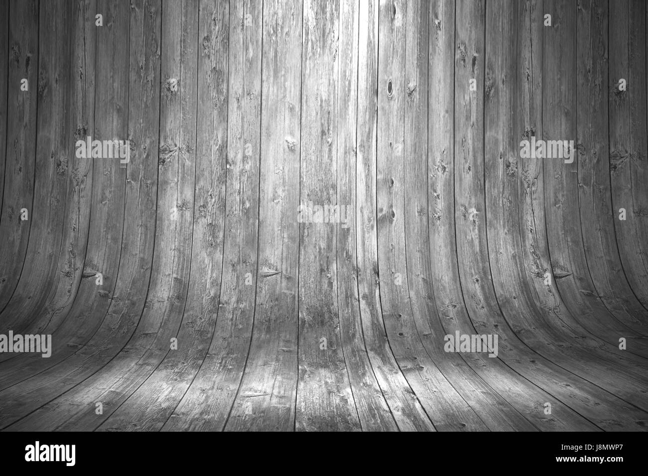 Old grungy grey curved wooden background with shining lamp on top - Stock Image