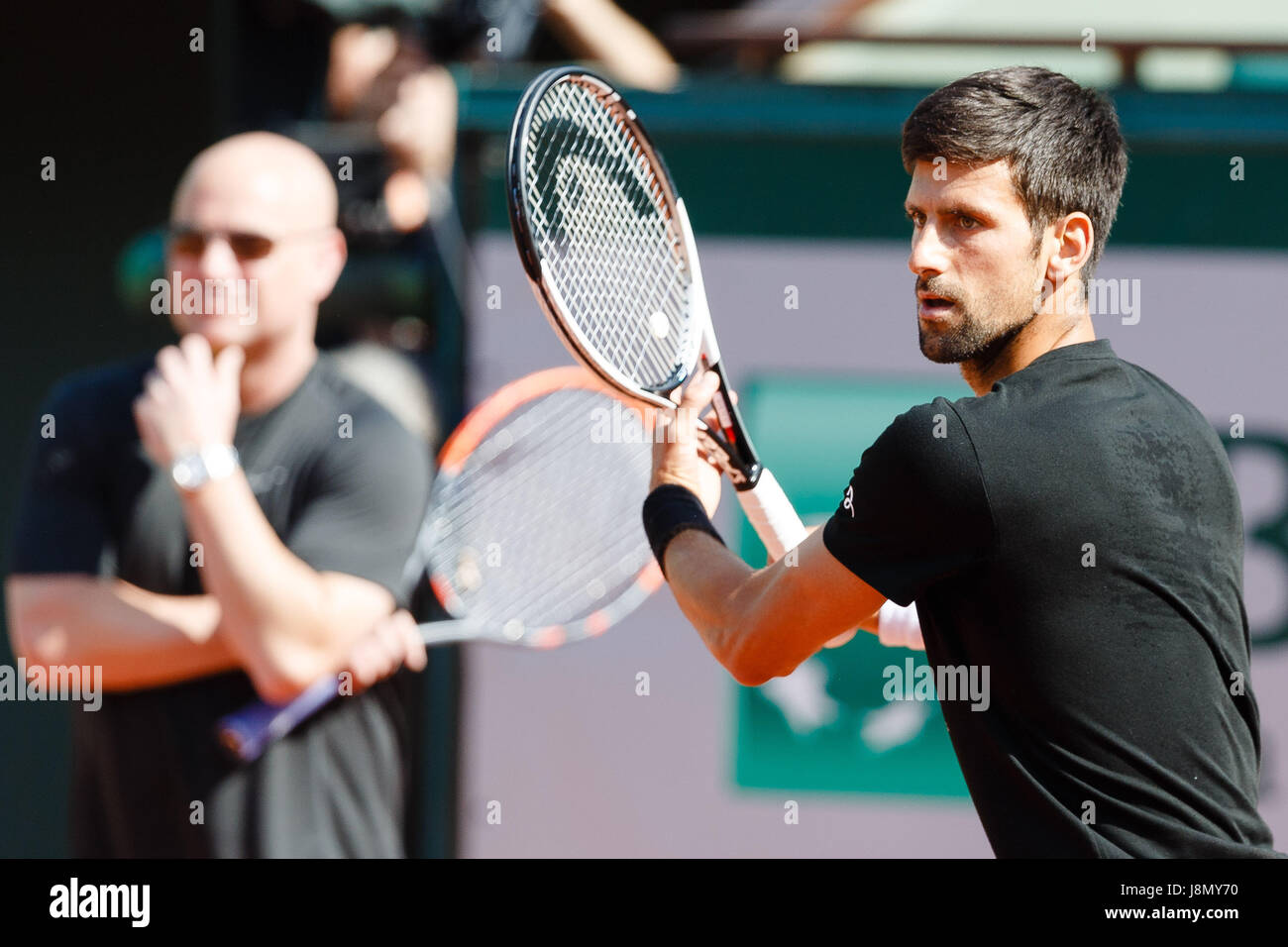 Paris, France, 29th May 2017, Tennis French Open: Novak Djokovic and his new coach Andre Agassi during a practice - Stock Image
