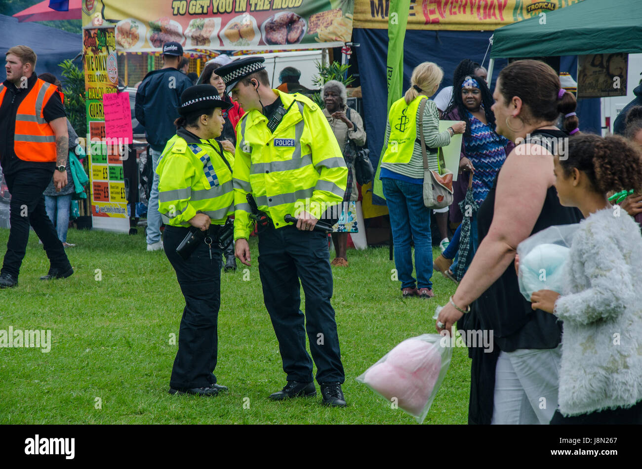 Reading, UK. 29th May, 2017. UK Weather: Reading carnival goes ahead despite light drizzle and grey clouds. Matthew - Stock Image